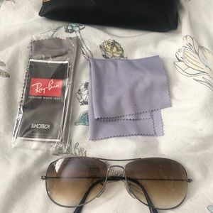 ray ban glasses with wipes and container to hold